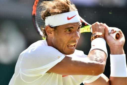 Opening up: Rafael Nadal plays first match on Centre Court