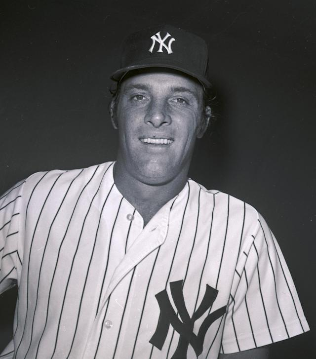 FILE - In this 1974 photo, New York Yankees infielder Mike Hegan poses for a photo during baseball spring training in Fort Lauderdale, Fla. Hegan, the former major league player who was a longtime broadcaster with the Cleveland Indians, has died. He was 71. The Indians say Hegan had his family by his side when he died Wednesday morning, Dec. 25, 2013, in Hilton Head, S.C. No other details were provided by the team. Hegan was a radio and TV broadcaster for the Indians for 23 years. He retired after the 2011 season. He also spent 12 seasons as a broadcaster with the Milwaukee Brewers. (AP Photo/File)