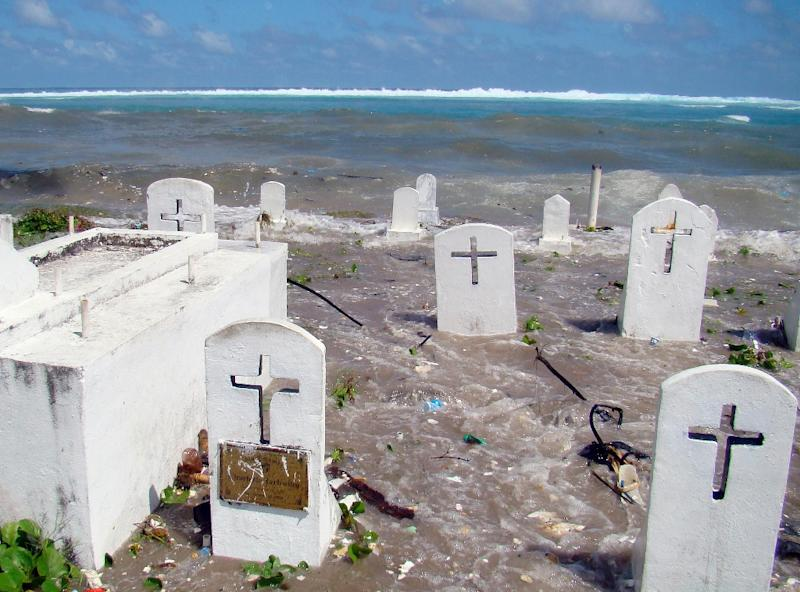 A cemetery on the shoreline in Majuro Atoll is flooded in 2008 by high tides and ocean surges in the low-lying Marshall Islands, a Pacific atoll chain that rises barely a metre above sea level (AFP Photo/Giff Johnson)