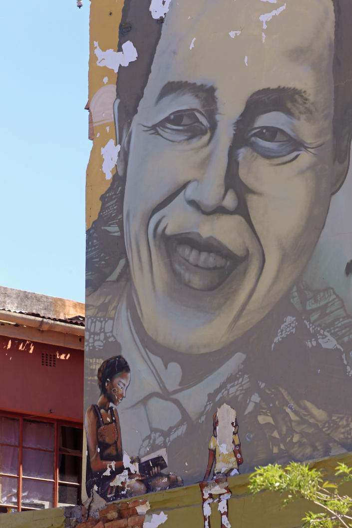 The face of former South African President Nelson Mandela is pictured on a mural with other South African apartheid freedom fighters, not pictured, in the city of Cape Town, South Africa, Sunday, March 10, 2013. South Africa's presidency says Nelson Mandela has spent a night in the hospital after he was admitted for tests. Presidential spokesman Mac Maharaj said Sunday there were no updates on 94-year-old Mandela's condition since he went to a hospital in Pretoria on Saturday afternoon.(AP Photo/Schalk van Zuydam)