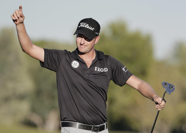 Webb Simpson points to fans after sinking a putt on the 18th green to win the STPC Summerlin, Sunday, Oct. 20, 2013, in Las Vegas. Simpson won the tournament finishing 24-under 260. (AP Photo/Julie Jacobson)