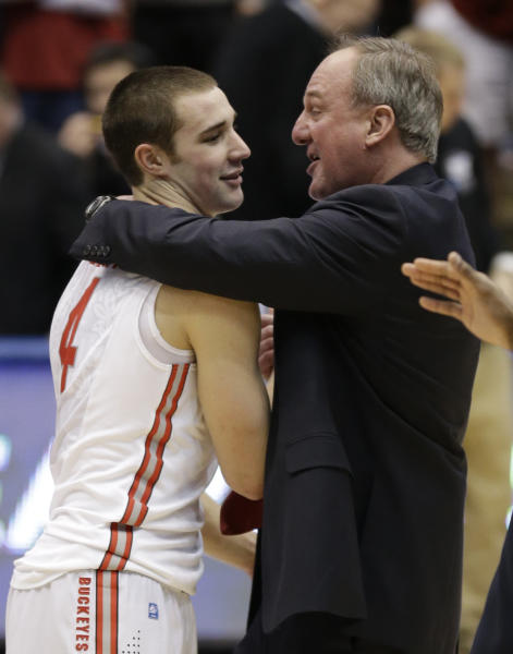 Ohio State head coach Thad Matta, right, hugs guard Aaron Craft (4) after they defeated Iowa State 78-75 in a third-round game of the NCAA college basketball tournament on Sunday, March 24, 2013, in Dayton, Ohio. Craft hit the game-winning three-point basket. (AP Photo/Al Behrman)