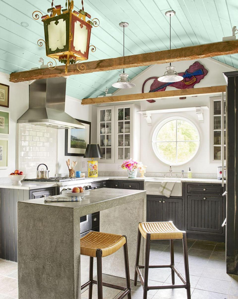 "<p>When you want to maintain neutrality but still have some fun in the kitchen, shoot for the stars—or in this case, the ceiling. Here, the Madcap Cottage team chose to paint the ceiling a Southern porch-inspired blue (Blue Ground by Farrow & Ball) and added an elaborate antique lantern.</p><p><a class=""link rapid-noclick-resp"" href=""https://go.redirectingat.com?id=74968X1596630&url=https%3A%2F%2Fwww.homedepot.com%2Fb%2FPaint-Paint-Colors%2FBlues%2FN-5yc1vZcaw8Z1z13o7a&sref=https%3A%2F%2Fwww.countryliving.com%2Fhome-design%2Fdecorating-ideas%2Fg3988%2Fkitchen-trends%2F"" rel=""nofollow noopener"" target=""_blank"" data-ylk=""slk:SHOP BLUE PAINT"">SHOP BLUE PAINT</a></p>"