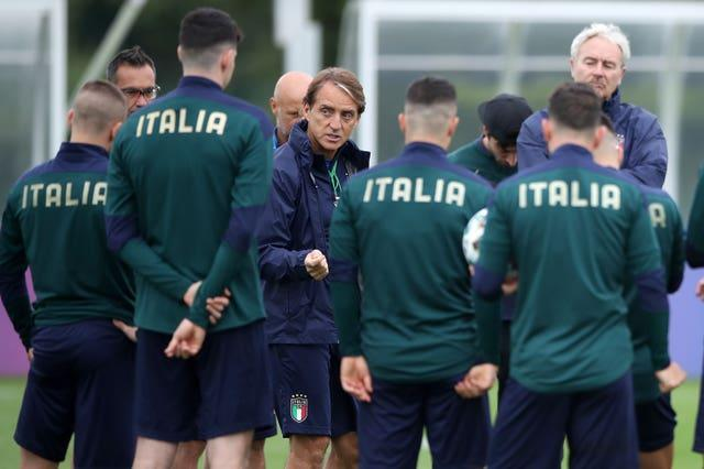 Italy manager Roberto Mancini with his players during a training session at Tottenham Hotspur's training ground