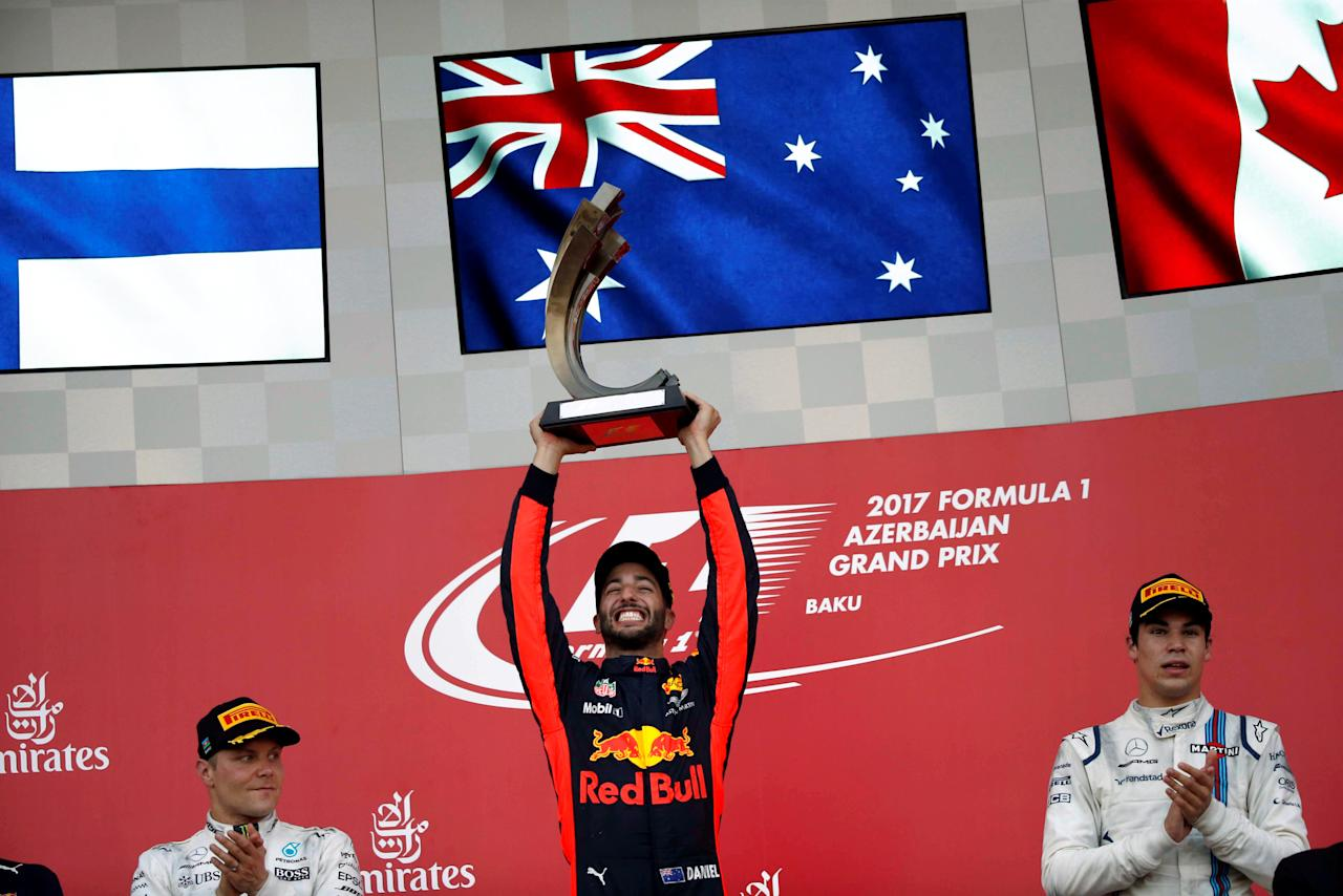 Formula One - F1 - Azerbaijan Grand Prix - Baku, Azerbaijan - June 25, 2017. Red Bull Racing Formula One driver Daniel Ricciardo of Australia celebrates his victory over second placed Mercedes' Valtteri Bottas and third placed Williams' Lance Stroll. REUTERS/David Mdzinarishvili     TPX IMAGES OF THE DAY