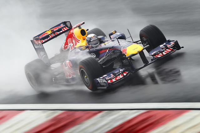 YEONGAM-GUN, SOUTH KOREA - OCTOBER 14: Sebastian Vettel of Germany and Red Bull Racing drives during practice for the Korean Formula One Grand Prix at the Korea International Circuit on October 14, 2011 in Yeongam-gun, South Korea. (Photo by Clive Mason/Getty Images)
