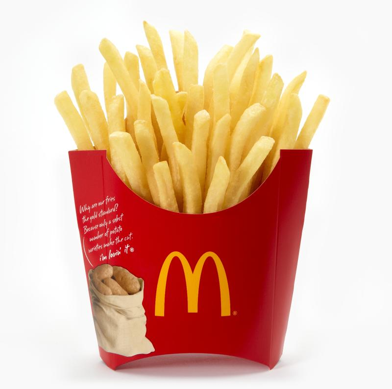 McDonald's french fries in iconic red packaging.