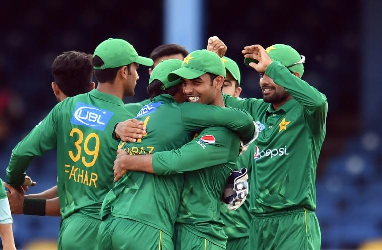 Pakistan's Shadab Khan (R) embraces team Pakistan's captain/wicketkeeper Sarfraz Ahmed as they celebrate their victory at the end of the second of four-T20I-match between West Indies and Pakistan March 30, 2017