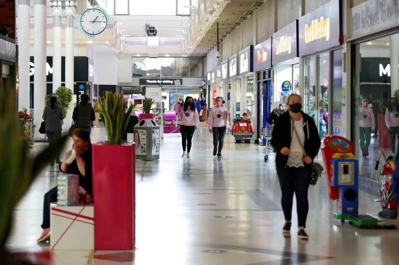 FILE PHOTO: Pink patrollers help and advise people to socially distance and wear masks inside the Weston Favell Shopping centre, in Northampton