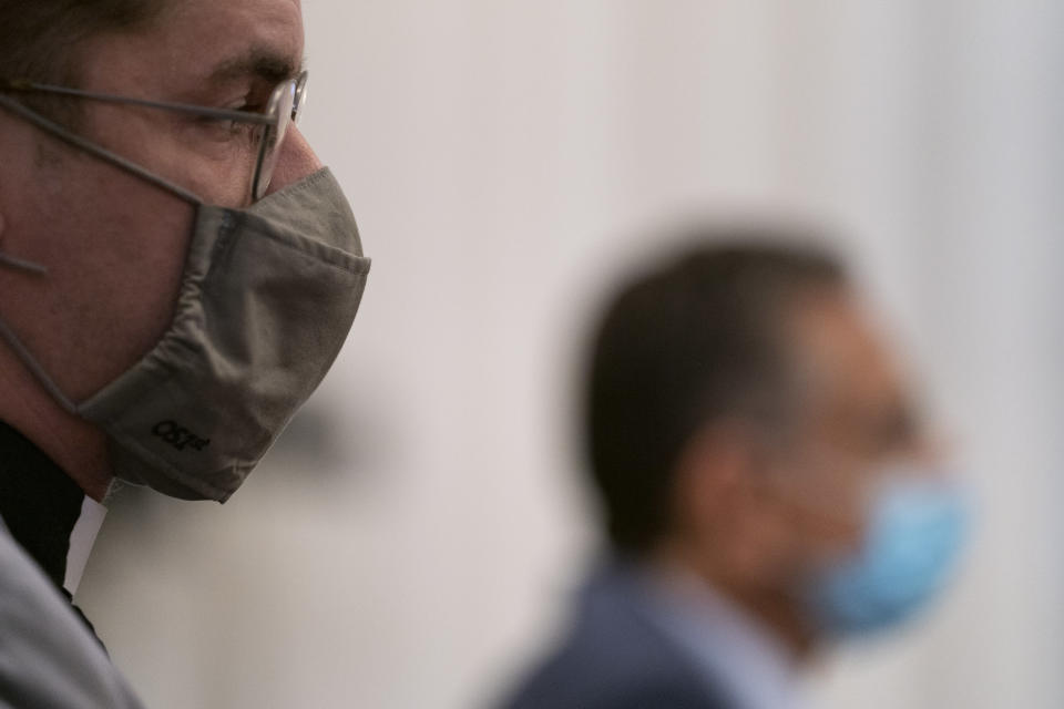 The Rev. Bob Lee, left, and Dr. Joseph Loconte, Associate Professor of History at The King's College in New York City, right, wear facemasks during a House Committee on Natural Resources, Subcommittee on National Parks, Forests, and Public Lands hearing on Capitol Hill in Washington, Tuesday, July 21, 2020, as they consider bills to remove Confederate statues. (AP Photo/Carolyn Kaster)