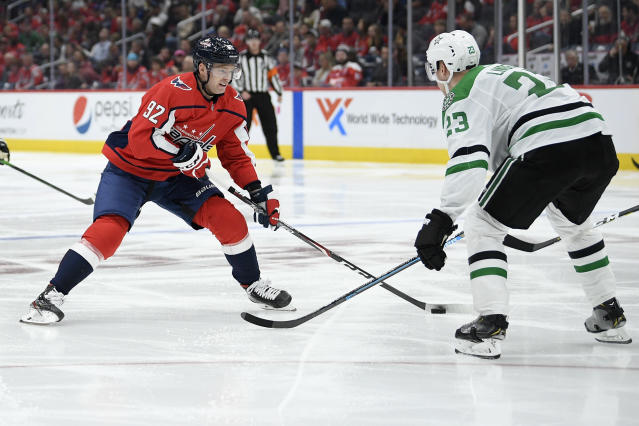 Washington Capitals center Evgeny Kuznetsov (92), of Russia, skates with the puck in front of Dallas Stars defenseman Esa Lindell (23), of Finland, during the third period of an NHL hockey game Tuesday, Oct. 8, 2019, in Washington. The Stars won 4-3 in overtime. (AP Photo/Nick Wass)