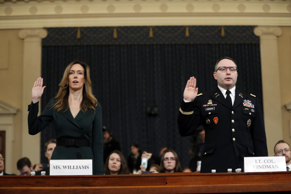 Jennifer Williams, an aide to Vice President Mike Pence, left, and National Security Council aide Lt. Col. Alexander Vindman, are sworn in to testify before the House Intelligence Committee on Capitol Hill in Washington, Tuesday, Nov. 19, 2019. (Photo: Andrew Harnik/AP)