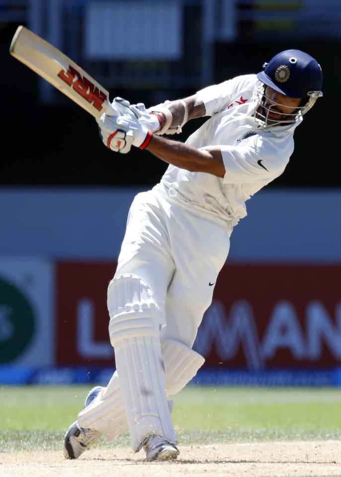 India's Shikhar Dhawan hits a six on his way to scoring a century during his second innings on day four of the first international test cricket match against New Zealand, at Eden Park in Auckland, February 9, 2014. REUTERS/Nigel Marple (NEW ZEALAND - Tags: SPORT CRICKET)