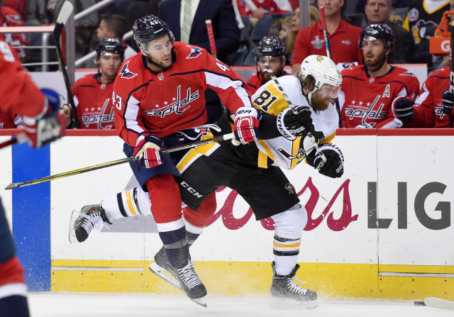 Washington Capitals right wing Tom Wilson (43) collides with Pittsburgh Penguins right wing Phil Kessel (81) during the first period in Game 2 of an NHL second-round hockey playoff series, Sunday, April 29, 2018, in Washington. (AP Photo/Nick Wass)