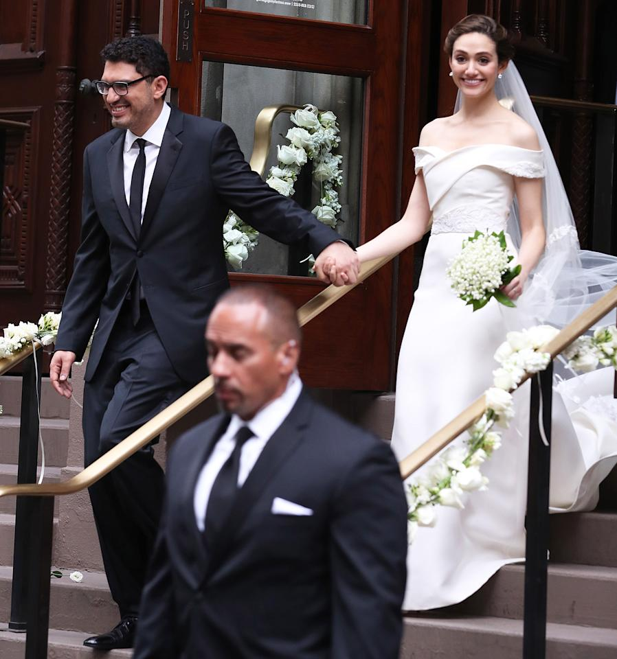 "<p>Emmy married director Sam Esmail in a <a rel=""nofollow"" href=""http://people.com/style/emmy-rossum-marries-sam-esmail-wedding/"">custom off-the-shoulder Carolina Herrera gown</a> that was partly inspired by her wedding reception venue, the Guggenheim museum. ""It was Mrs. Herrera's idea to make it quite modern and fresh, and kind of use the shape of the Guggenheim on the bodice,"" Rossum told <i><a rel=""nofollow"" href=""http://www.vogue.com/article/emmy-rossum-wedding-2017-carolina-herrera"">Vogue</a></i>. </p>"