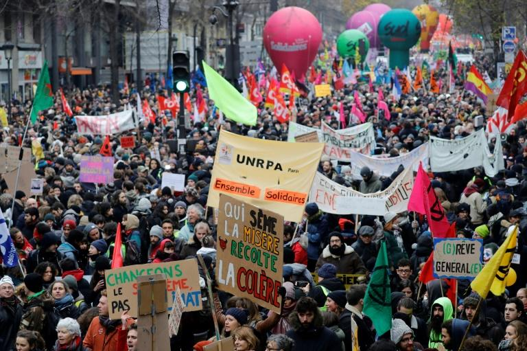 The huge demonstrations across the country added to walkouts that paralysed transport services and closed schools (AFP Photo/Thomas SAMSON)