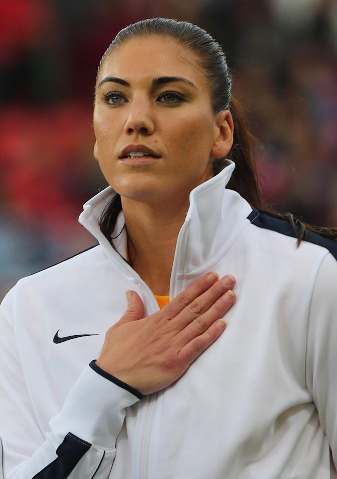 MANCHESTER, ENGLAND - JULY 31:  Hope Solo of USA looks on during the national anthem during the Women's Football first round Group G match between the United States and DPR Korea on Day 4 of the London 2012 Olympic Games at Old Trafford on July 31, 2012 in Manchester, England.  (Photo by Stanley Chou/Getty Images)
