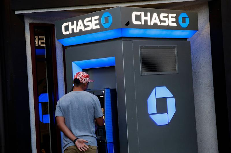 Customers use a JPMorgan Chase & Co. bank ATM in the Little Tokyo neighborhood of Los Angeles, California, U.S., on Tuesday, July 7, 2015. JPMorgan Chase & Co. is scheduled to announce quarterly earnings results on July 14. Photographer: Patrick T. Fallon/Bloomberg via Getty Images