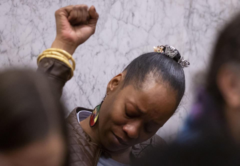 """FILE - In this Feb. 20, 2020, file photo, Demetria Hester reacts to verdicts of guilty on all twelve counts at the Jeremy Christian trial in Portland, Ore. One of the protesters arrested in Portland, Oregon early Monday, Aug. 10, 2020, is a Black woman who was assaulted by a white supremacist in a high-profile case three years ago and who now leads a group of """"moms"""" in racial justice protests each night. Hester, 46, was booked on suspicion of disorderly conduct and interfering with a police officer during a protest that began Sunday night and stretched into the early morning hours. (Beth Nakamura/The Oregonian via AP, Pool, File)"""