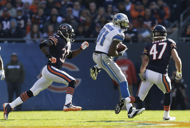 Detroit Lions wide receiver Calvin Johnson (81) makes a reception against Chicago Bears cornerback Charles Tillman (33) and safety Chris Conte (47) during the first half of an NFL football game, Sunday, Nov. 10, 2013, in Chicago. (AP Photo/Nam Y. Huh)