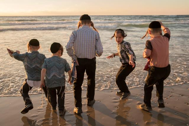 "<p>Ultra-Orthodox Jewish boys perform the ""Tashlich"" ritual along the Mediterranean Sea in the Israeli city of Herzliya, near Tel Aviv, on Sept. 28, 2017, during which ""sins are cast into the water to the fish"". The ""Tashlich"" ritual is performed before the Day of Atonement, or Yom Kippur, the most important day in the Jewish calendar, which in 2017 starts at sunset on Sept. 29. (Photo: Jack Guez/AFP/Getty Images) </p>"