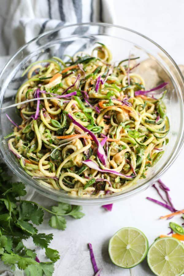 """<p>There's nothing as healthy as a bowl of zoodles for dinner, which are high in water content and are low in calories per volume. (So, you can eat a whole bunch.) Yet sometimes they get a bad reputation for being boring """"diet"""" food. This salad by<a href=""""https://therealfoodrds.com/spicy-asian-zucchini-noodles/"""" rel=""""nofollow noopener"""" target=""""_blank"""" data-ylk=""""slk:The Real Food Dietitians"""" class=""""link rapid-noclick-resp""""> The Real Food Dietitians</a> isn't bland at all though. With creamy almond butter sauce, grated ginger, garlic, and cayenne, it packs a ton of flavor.</p>"""
