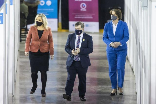 Northern Ireland Minister for Health Robin Swann with First Minister Arlene Foster (right), and deputy First Minister Michelle O'Neill