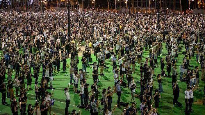 People take part in a vigil to remember the victims of the 1989 Tiananmen Square Massacre in Hong Kong, on 4 June, 2020