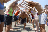 """Dan O'Conor, the """"Great Lake Jumper,"""" makes his way through a tunnel for his 365th leap into Lake Michigan, Saturday, June 12, 2021, in Chicago's Montrose Point. (AP Photo/Shafkat Anowar)"""