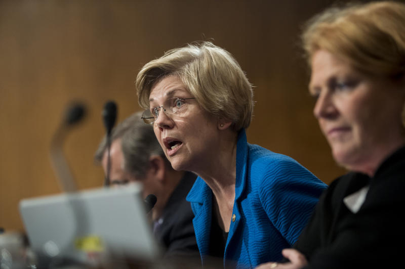 UNITED STATES - JULY 15: Sen. Elizabeth Warren, D-Mass., questions Consumer Financial Protection Bureau Director Richard Cordray during the Senate Banking, Housing and Urban Affairs Committee hearing on the CFPB's semi-annual report to Congress on Wednesday, July 15, 2015. (Photo By Bill Clark/CQ Roll Call)