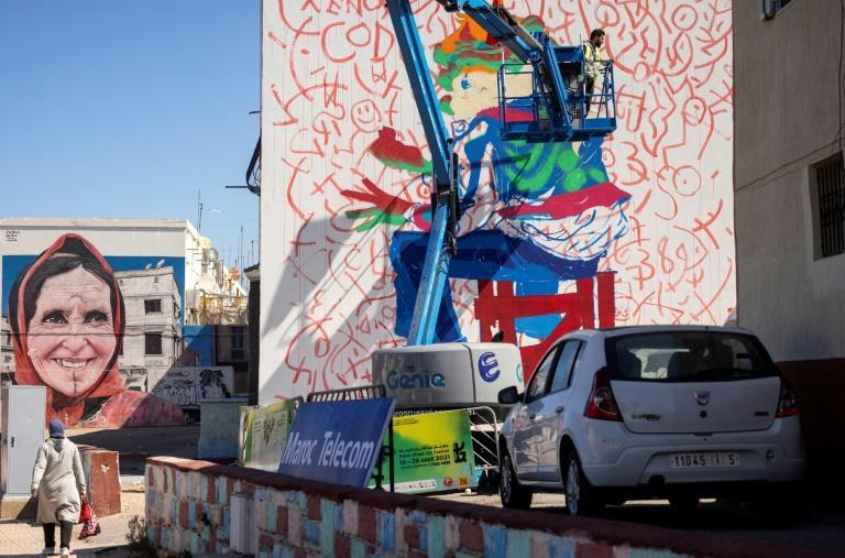 Lhamzi used the side of a house in the working-class district of Yaacoub Al Mansour for his latest work (AFP/FADEL SENNA)
