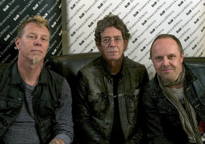 "In this Oct. 24, 2011 photo, Metallica members James Hetfield, left, and  Lars Ulrich, right, pose with musician Lou Reed in New York.  Metallica and Reed teamed up for Reed's latest release, ""Lulu."" (AP Photo/John Carucci)"