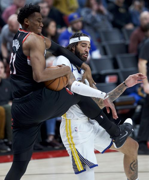 Portland Trail Blazers center Hassan Whiteside, left, and Golden State Warriors center Willie Cauley-Stein vie for the ball during the second half of an NBA basketball game in Portland, Ore., Monday, Jan. 20, 2020. (AP Photo/Craig Mitchelldyer)