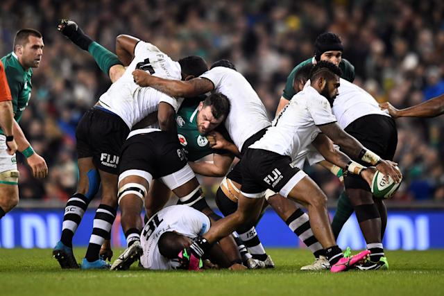 Rugby Union - Autumn Internationals - Ireland v Fiji - Aviva Stadium, Dublin, Republic of Ireland - November 18, 2017 Ireland's Cian Healy is tackled as Fiji's Nikola Matawalu kicks upfield REUTERS/Clodagh Kilcoyne