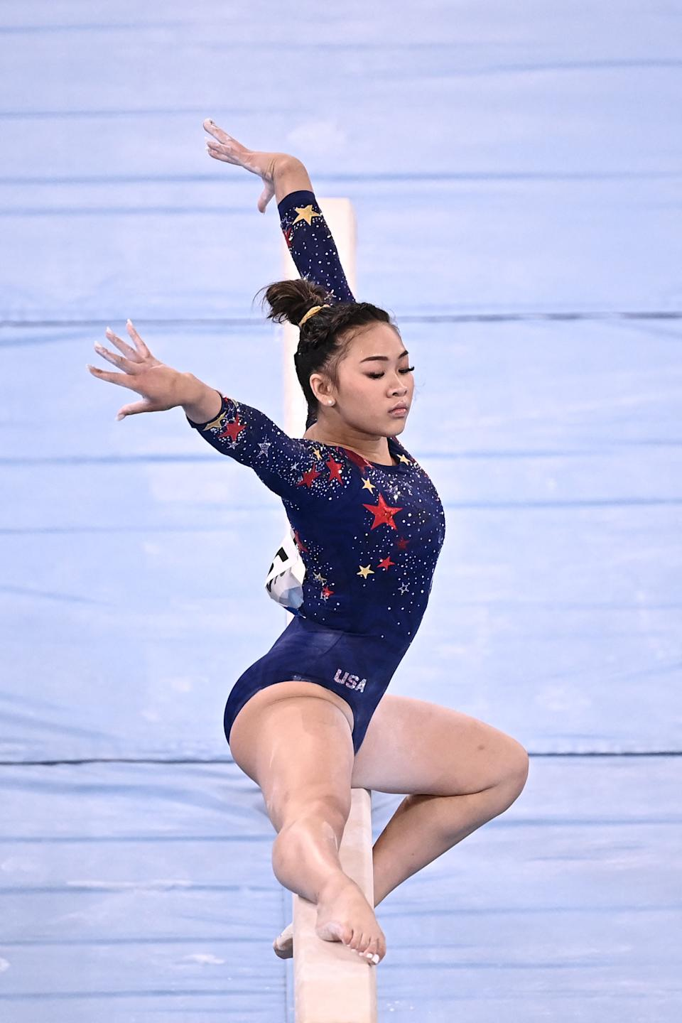 <p>USA's Sunisa Lee competes in the artistic gymnastics balance beam event of the women's qualification during the Tokyo 2020 Olympic Games at the Ariake Gymnastics Centre in Tokyo on July 25, 2021. (Photo by Lionel BONAVENTURE / AFP) (Photo by LIONEL BONAVENTURE/AFP via Getty Images)</p>