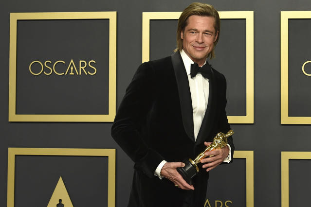 Brad Pitt, winner of the Oscar for best performance by an actor in a supporting role for <em>Once Upon a Time... in Hollywood</em>, poses in the press room at the ceremony. (Jordan Strauss/Invision/AP)