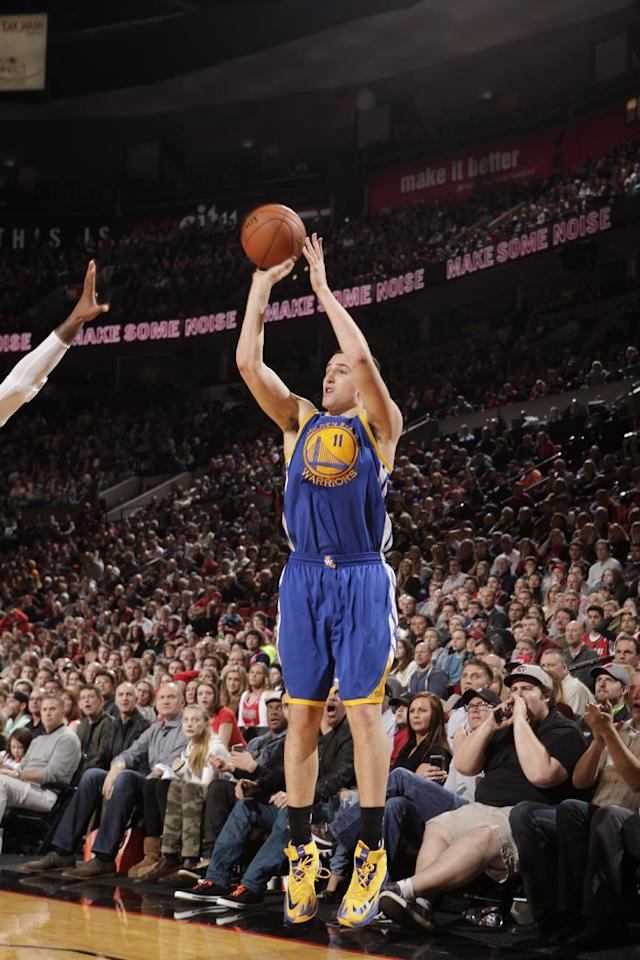 PORTLAND, OR - MARCH 16: Klay Thompson #11 of the Golden State Warriors shoots against the Portland Trail Blazers on March 16, 2014 at the Moda Center Arena in Portland, Oregon. (Photo by Cameron Browne/NBAE via Getty Images)