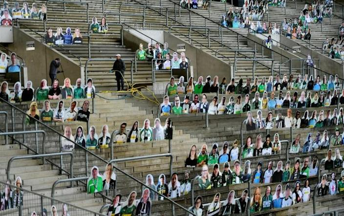 Borussia Moenchegladbach are planning to fill their stadium with cardboard cut-outs of fans when the season resumes (AFP Photo/Ina FASSBENDER)