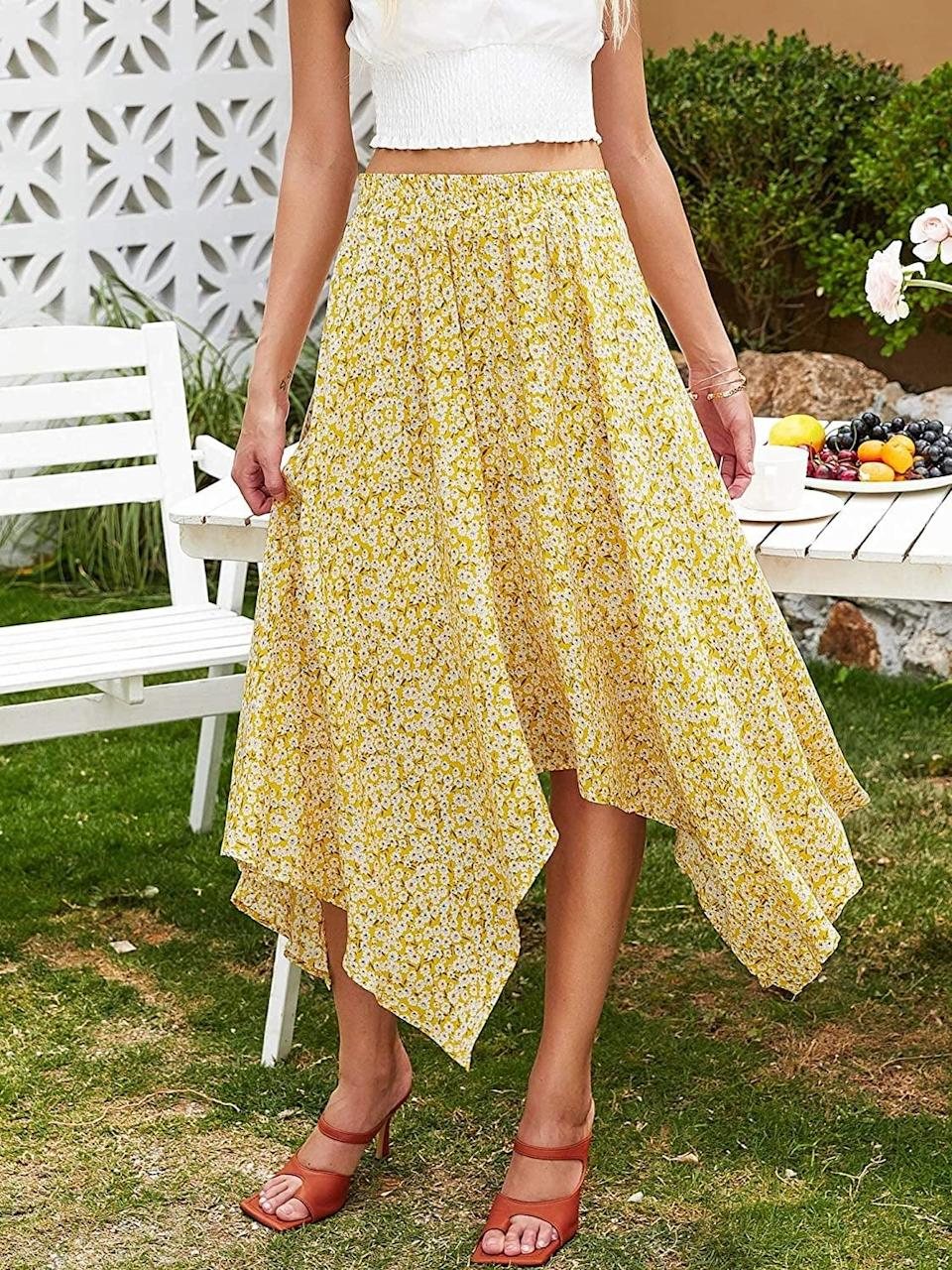 <p>You can't go wrong with a floral flowy skirt and this <span>Hibluco Women's High Waist Asymmetrical Boho Midi Skirt</span> ($27) is such a cute find. You can dress it up or down and look chic either way. </p>