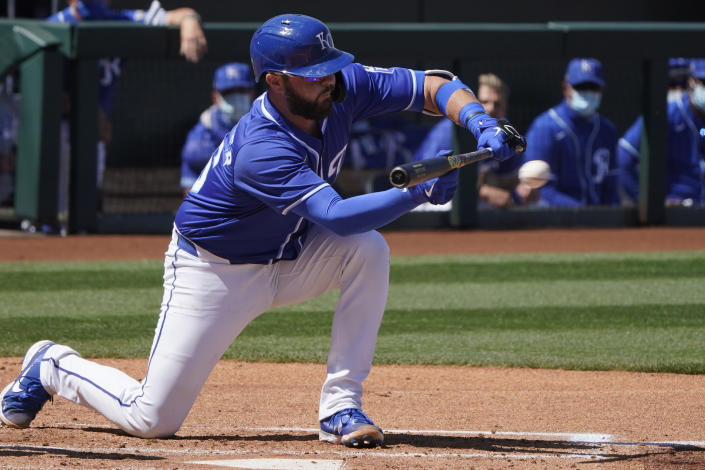 Kansas City Royals' Cam Gallagher hits a sacrifice bunt to score Hanser Alberto in the second inning of a spring training baseball game against the Colorado Rockies, Sunday, March 21, 2021, in Surprise, Ariz. (AP Photo/Sue Ogrocki)