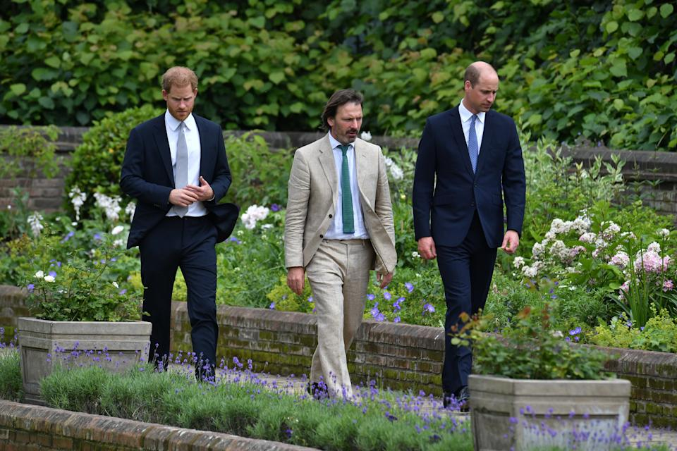 The brothers and garden designer Pip Morrison walk through the newly designed garden. (Photo: PA Images)