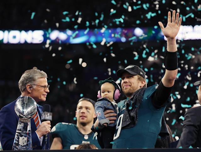 <p>Philadelphia Eagles quarterback Nick Foles (9) celebrates with his daughter Lily Foles after defeating the New England Patriots 41-33 in Super Bowl LII at U.S. Bank Stadium. Mandatory Credit: Matthew Emmons-USA TODAY Sports </p>