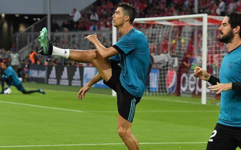 "It looks like Cristiano is heading for a meeting with Mo as Real Madrid took a lead, and two away goals, with them to the second-leg of their Champions League semi-final against Bayern Munich in Spain next week. Given the wildly fluctuating score-lines that this competition can provoke and given Juventus went so close in scoring three times at the Bernabeu in the last round then Bayern cannot be ruled out, and felt they should have won and not lost here, just as Roma will hope they can overturn Liverpool's 5-2 Mohamed Salah-inspired advantage. But it does seem to be set for Real Madrid versus Liverpool, Cristiano Ronaldo, who was quiet on this occasion, failing to score for the first time in 12 games, against Salah whose exploits were played on the big screen prior to kick-off and whose name was on everyone's lips. Liverpool should fancy their chances against this Real defence and goalkeeper Keylor Navas but they will also know the threat posed by the most successful team in European history and their talisman in what would be a re-run of the 1981 European Cup Final. A Kenny Dalglish-led Liverpool won then. Now they have his heir, Salah. But this Real always seem to find a way and that is their greatest strength. They inflicted Bayern's first home defeat of the season and how bitter it was for the Germans that they should succumb to these opponents. Again. This is the most recurring match-up in Europe, a 25th meeting of these super-clubs, but Real have won the last six. Including winning here last season, by the same score-line, in the quarter-finals. Bayern were deeply unfortunate in the second leg and they will have believed that the Gods conspired against them once more. Not only did they lose but they lost Arjen Robben, Jerome Boateng and Javi Martinez to injury. Real Madrid players celebrate Asensio's goal Credit: REUTERS Their evening was summed up when Thomas Muller and Robert Lewandowski got in each other's way as one of them had to score with the Bayern captain then claiming a penalty after he kicked Raphael Varane with an air-shot. It was that kind of night for Bayern with Franck Ribery grabbed by a pitch invader at the final whistle. Real did what Real do. They did not play particularly well but they won. ""We will have to fight in the second leg and in football everything is possible. You can't say anything is decided,"" coach Zinedine Zidane said but his team showed that big-game mentality he boasted about on the eve of this tie. With Ronaldo below his best – one shot went for a throw-in while after he netted superbly with another it was rightly ruled out for hand-ball – others stepped up and not least captain Sergio Ramos. Possession: FC Bayern vs Madrid Still it was a record 96th Champions League win for Ronaldo with Real on course to win this trophy for a 13th time, and a third season in a row, and in doing so end the run of Bayern coach Jupp Heynckes who has won his last two campaigns in the European Cup and who is retiring – again. These were two heavyweights, two teams stacked with big names who, surprisingly, made big mistakes. Each of the three goals followed clear errors. Bayern went ahead when Marcelo failed to get back in time and they took a quick goal-kick to exploit the space he left with James Rodriguez sliding the ball through to Joshua Kimmich. FC Bayern vs Madrid shots on goal The full-back ran on but, even so, it was a tight angle although Navas gambled on a cross and was caught out as he wafted a hand and the ball sailed between him and his near post. Then, maybe, there was the game's pivotal moment when Ribery was put clear but the ball went to Navas after a woefully heavy touch. Just as Zidane was surely pondering another half-time re-think, Real scored. Maybe it was Ronaldo shaping for another bicycle kick that distracted Bayern but they did not react as the ball ran to Marcelo who drove it low first-time across goal and in. FC Bayern 1 - 2 Madrid (Marco Asensio, 57 min) ""It was a present to Real Madrid,"" Heynckes said. ""Like the second goal. We created so many goal-scoring chances but we were not clinical. I have not seen anything like that. We will give everything we have to make up for this result in the second-leg. It's our duty."" Bayern paid the price again. As they pushed in the second-half, they were caught out. Real broke from a corner but Bayern had the change to clear only for Rafinha to stumble and play the ball straight to Marco Asensio. Suddenly it was two against one and the substitute exchanged passes with Lucas Vazquez before coolly steering the ball beyond goalkeeper Sven Ulreich. There was one last chance for Bayern with substitute Corentin Tolisso putting Lewandowski through. He tried a Salah dink. But he sent the ball wide. 9:53PM Bad Bayern Munich stat 6 - Bayern Munich have lost their last 6 games against Real Madrid in the Champions League, their worst losing run against an opponent in the competition. Olé. #FCBRMApic.twitter.com/W5g48kZvjO— OptaJean (@OptaJean) April 25, 2018 9:49PM Fans on the pitch at the final whistle Some people managed to get onto the pitch at the final whistle and were seen running chased by stewards. Half a dozen fans have just run on the pitch. One seemed to grab Franck Ribery before he was tackled by stewards.— Rory Smith (@RorySmith) April 25, 2018 Here's one of them. Taking a selfie. Why. WHY. WHYYYYYYYYYYYYYYYYYYYY Credit: REUTERS Credit: REUTERS Credit: REUTERS He looks devastated in that final one. The pitch invader, not the players. 9:47PM Expected goals xG map for Bayern Munich - Real Madrid. Instead of asking, ""do we want the threepeat"" instead we should ask, ""what does the threepeat want of us?"" pic.twitter.com/D5ZWR1h4C2— Caley Graphics (@Caley_graphics) April 25, 2018 FC Bayern vs Madrid shots on goal 9:44PM Team shapes Average touch positions (0 min) Hummels, Rafinha and Ribery had most of the ball for Bayern but you can see how defensive Real's shape was tonight. 9:39PM FULL TIME That's it! Real Madrid win with two away goals! A tremendous result for Zidane, Heynckes has to work out a masterplan to turn this around in Madrid. 9:38PM 90 mins +4 Bayern still looking hopefully for an equaliser but it doesn't look like one's coming from anywhere. Real Madrid are doubling up on Ribery on the left now - he and Kimmich have been the best players for Bayern all evening - and cutting out anything dangerous. 9:37PM 90 mins +2 The counter-attack is on! James gets a pass to feet but it takes him wider than he wants and he has to turn back. Real Madrid can get back into their defensive shape and then Modric is able to steal the ball and sends Benzema on his way. He doesn't spot Asensio in a mile of space to his left and gives away a free-kick by playing an offside Vasquez in instead. 9:34PM 90 mins Kovacic absolutely charges out of his own box to chase the ball and lead a counter-attack from Real's box to Bayern's. He's completely wiped out before he even reaches the halfway line by Thiago, who is booked. 9:32PM 89 mins Ronaldo is back defending now, following Kimmich's run and shielding the ball out for a throw-in. Bayern pass around a bit and then suddenly LEWANDOWSKI IS IN! Huge chance! Tolisso passes around the corner of the defender, Lewandowski is one on one but puts his shot well wide of the post. That's a bad miss. 9:30PM 87 mins Ribery floats a high ball into the area and Real Madrid players look it as though they've never had to deal with a cross before. Marcelo boots it into the air, nobody heads out... and Ribery wins a free-kick wide left from Kovacic's foul. 9:28PM 85 mins Credit: AFP Kovacic is on for Casemiro, who was on a yellow card. Bayern still in possession but can't quite seem to work out how best to use it. Some of the Bayern players look shattered too. 9:26PM 83 mins Possession: FC Bayern vs Madrid Sule waits for Asensio to get close as he shields the ball and throws himself to the ground, winning a free-kick. That's the first poor decision the referee's made all game. Ronaldo tries to put Vasquez in on goal but the goalkeeper is able to smother it. 9:25PM 81 mins Bayern have a corner. James takes it but Varane gets up well to head away. Real drop deep and deal with the danger easily, Ribery's early cross helping matters as it goes straight out for a throw. 9:22PM 79 mins Casemiro catches James with a late tackle 25/30 yards out and is booked for it. This could be a shot or a cross... Thiago stands over it... and curls to the back post. Ramos clears. 9:21PM 77 mins Martinez off, Tolisso on. Lewandowski controls the throw on his chest and then goes on a run like a dolphin back inside the pitch with the ball on his head. He's put his team in trouble here! Lewandowski tries a backheel flick to get rid of the ball but has set up Benzema! He touches it past the defender and only has the goalkeeper to beat but is wide of the six yard box... and Ulreich gets down well to block. 9:19PM 75 mins Credit: AFP Thiago is outraged that the referee has given Real Madrid a free-kick for a foul on Modric and he charges towards him, soundtracked by an aggrieved, extremely loud crowd. It's the right decision again. Oh to be a referee. The free-kick is headed away and then goes out for a throw to Bayern. 9:16PM 72 mins WHAT A GOAL! WOW. Wowowowowow. Ronaldo peels away from the last man, Modric hooks the ball over the top to him and he brings it down on his chest/shoulder... actually that might be an arm... but Ronaldo keeps going and lashes a left footed volley from 20 yards into the bottom corner. It's a brilliant finish... but the referee says handball. And he's right. Possession: FC Bayern vs Madrid 9:14PM 71 mins Ribery is getting closer and closer. Vasquez is the right-back now, in theory, and that might not be the safest of defensive options. Ribery finds space, cuts onto his right foot and thumps a shot at goal. Wide of the far post. Is... is Ronaldo playing in central midfield now? 9:12PM 68 mins The corner is whipped into the area and there's a scramble! Muller can tap into an empty net! But somehow Real survive... and now Martinez is down clutching his head... and Real Madrid are attacking. 9:11PM 67 mins Zidane is telling Carvajal to go down injured - because he's injured - but the right-back plays on. Bayern win a corner, Carvajal goes down. Thiago isn't impressed, the Bayern support really don't like it... but now Benzema is actually coming onto the pitch. 9:09PM 65 mins Is Carvajal coming off here? He's trying to take a throw-in, even though he's about to be replaced by Benzema. And that's a pretty weird substitution as it is. Vasquez at right-back? 9:07PM 63 mins Lewandowski goes down under a challenge by Casemiro but the referee doesn't care. Bayern slow down and wait for him to get back on his feet - I'm really happy this a thing now - as the striker makes a miraculous recovery after learning he won't get a free-kick. Kimmich attacks down the right, James switches play, Real Madrid are forcing Bayern to play around them. Ribery gets lucky with a rebound and blasts a low shot at goal but too close to Navas, who saves. And now Carvajal has gone down with what might be a hamstring injury. Is this pitch haunted or something? 9:05PM 61 mins Navas makes a brilliant save from Ribery's shot inside the box! Interception: FC Bayern 1 - 1 Madrid (Raphael Varane, 51 min) 9:01PM GOOOOOOOOAAAAAAAAAAAALLLLLLL! asensio goal ASENSIO SCORES! It's a huge mistake by Rafinha that gifts this one. The corner is cleared, Rafinha is one of two back near the halfway line and he tries to pass across the pitch. That's dangerous to start with but he does so while off-balance! Asensio steals it, passes to Vasquez, who gets his return pass dead on and Asensio stays composed to dink the ball over the goalkeeper. Two away goals for Real Madrid! FC Bayern 1 - 2 Madrid (Marco Asensio, 57 min) 9:01PM 57 mins The crowd roars as Bayern attack quickly! Marcelo is out of position again, the ball is wide right and Muller swings it towards Lewandowski at the back post! He has to head it back across goal. Navas has the ball stolen from him by Modric. Corner. And REAL ARE AWAY HERE! 8:59PM 56 mins Asensio wins a throw-in off Kimmich and Marcelo takes his time walking up the line to take it. Benzema is getting warmed up on the sidelines. A change of shape for Real? 8:58PM 55 mins FC Bayern vs Madrid shots on goal 8:57PM 53 mins Ribery is booked for leaving a little extra in a challenge on Varane, who yelps in pain as he does. The referee has to deal with the entire stadium deeming this unfair, booing and jeering, and the rest of the Bayern players buying into that attitude. 8:55PM 51 mins Ribery tries to get Bayern going down the left but Real deal with it, with Navas missing his punch and Ramos heading away. Ribery is in again on the left now though! He faces up to his man on the corner of the six yard box... and he's completely binned Casemiro with a shift of feet! His low cross into the box is deflected away before Muller can tap into an empty net! So close! 8:52PM 48 mins Asensio might mean that Real have someone who sticks out on the left rather than roaming inside like Isco tends to, which will help Ronaldo stay in central positions more often. I think it's an attacking substitution by Zidane. Asensio's first involvement isn't great though and he gives the ball away to Bayern. Ronaldo takes the ball on as it rolls loose, sets himself up for a shot and then takes it! Urgh. That's about 10 yards wide of the corner flag. Miss: FC Bayern 1 - 1 Madrid (Cristiano Ronaldo, 47 min) 8:49PM KICK OFF 2 kick off 2 bayern Isco off, Asensio on. 8:41PM Marcelo celebrating Credit: REUTERS 8:39PM Real Madrid's gameplan McManaman has been complaining that Ronaldo hasn't touched the ball enough and that Kroos and Modric have been poor but I'm not sure he's seeing the bigger picture here (says the writer about a Champions League winning player). Zidane has set his team up to contain, frustrate and hit on the counter-attack. Bayern Munich's biggest threat is their counter-attack - allowing them to do that is suicidal and so sitting deep, staying patient and denying space for the Germans in the final third is a good way to keep the score down. The Allianz is incredibly difficult to go to and get a result so the pragmatist, safe and sensible option is look to keep things quiet and take a low score defeat or draw back the Bernebeu where the Galacticos can turn on the style. Credit: GETTY IMAGES They've done it pretty well so far. Bayern were always going to have chances and were it not for Navas' mistake at the near post, might not have scored there at all. Zidane's won the trophy twice in a row, he knows what he's doing. Ronaldo is playing on the left wing when Real Madrid are defending so it's basically a 4-6-0 formation. When they get up the pitch he moves central to get on the end of crosses. Average touch positions (half time) Those crosses generally come from Vasquez on the right, which explains his selection ahead of Benzema. You can't just go to Bayern Munich and play your attacking players and assume you'll win. It's hard! 8:33PM HALF TIME Real Madrid have what they came for (an away goal), have kept Bayern mostly quiet until the final few minutes and it's been pretty equal. A rather entertaining semi-final! 8:33PM 45 mins +2 MULLER AT THE BACK POST! Just wide! 8:32PM 45 mins +1 Bayern have one last chance before half time. A free-kick wide left is hooked in and Lewandowski is there! He heads down, Navas parries and then scrambles to get up and smother it. He should probably have kept that safe first time. Regardless, Real survive. 8:30PM GOOOOOOOOOOOAAAAAAAAAAAAAAAAALLLL! bayern 1 1 real madrid MARCELO SCORES! Real move up the pitch, the ball drops for Marcelo on the edge of the area and he hits a brilliant shot across the goal into the bottom corner. FC Bayern 1 - 1 Madrid (Marcelo, 44 min) Real have what they came for! 8:29PM 43 mins Steve McManaman is moaning about Real Madrid's lack of time on the ball and, basically, their tactics. I'll lay into that at half time. 8:27PM 41 mins Bayern are really pulling strings now. They have all the ball and are finding space in Real's half. Corner. It's flicked on at the near post and HUMMELS IS THERE! He's volleyed over from six yards! What a miss! 8:24PM 38 mins Bayern keep surrounding the referee whenever a Real Madrid player fouls one of theirs. Rafinha has theatrically reacted to going over Carvajal's leg and a stadium full of people whistling and jeering doesn't yield a yellow card. 8:22PM 36 mins Credit: AFP That's Kimmich finishing past Navas at the near post. 8:21PM 35 mins Niklas Sule, an extremely highly-rated young centre-back has come on to replace the injured Boateng. 8:20PM 34 mins Bayern have Real Madrid pinned back in their own defensive third, Ribery twists and turns on the left and hits in a cross... and Navas throws himself at it like he's Superman. A double fist punch gets it away when he could easily have caught the ball. That's a nervous goalkeeper. AND RIBERY IS IN! One on one with the goalkeeper, he MUST SCORE BUT NO! His second touch is really bad and rolls to Navas. Real Madrid get away with that one. 8:17PM 32 mins More bad news for Bayern. Boateng has gone down! It looks like a muscle injury, either groin or hamstring, and he's hobbled off the pitch. 8:17PM 31 mins Interestingly, the assist for that goal came from James, the on-loan-from-Real-Madrid man. Bayern get in behind straight away again and Lewandowski goes down! No penalty. 8:14PM GOOOOOOOOOOOOAAAAAAALLLLL! bayern goal Where did that come from?! Marcelo is caught completely out of position as a quick Bayern attack puts Kimmich into an ocean of space on the right wing. He sprints to wide of the box, looks up to see who he can cross to... and blasts the ball past the goalkeeper at the near post! It's an awful mistake by Keylor Navas - that should never have happened! FC Bayern 1 - 0 Madrid (Joshua Kimmich, 28 min) 8:12PM 27 mins Real Madrid win a corner but Ramos ruins it by fouling someone in the area. Ronaldo keeps drifting out to the left wing as Real attack, then moving into a central position as the team gets forward. 8:10PM 25 mins Real have started attacking now they're over the opening quarter of the game. They've done well to keep Bayern quiet until this point but seem to have gone up a gear. Carvajal gets into the box and strikes at goal from a one-two! But he hits it straight at the goalkeeper. Attempt Saved: FC Bayern 0 - 0 Madrid (Daniel Carvajal, 23 min) 8:08PM 23 mins James puts in a meaty tackle on Vasquez. Friends no more! And Thiago puts the ball out of play again! He's been poor since replacing Robben. Possession: FC Bayern vs Madrid 8:06PM 21 mins Real Madrid get forward properly for the first time all game. Ronaldo finds space on the right, gets near the box and just has to play it low across the six yard box to set up a certain goal! But it's knocked behind for a corner. Bayern deal with that, then catch Kroos offside from the resulting corner that follows. 8:05PM 19 mins Bayern get into the Real half, players start moving, passes are quick and one-touch and then Rafinha puts it onto his right foot and launches one from distance! Saved! The strike is decent but hit too close to the goalkeeper, who keeps hold of it with safe hands. Attempt Saved: FC Bayern 0 - 0 Madrid (Rafinha, 19 min) 8:03PM 18 mins Credit: REUTERS 8:03PM 17 mins Ronaldo is on the ball! He attacks on the left wing, cuts inside onto his right as he goes past Boateng and goes down on the edge of the area! The referee says no foul. FC Bayern vs Madrid 8:01PM 15 mins Real can't keep the ball at the moment. Bayern are moving it around so well, making the pitch nice and big and running towards goal... but Hummels punts the ball out for a throw accidentally and now Real can play a bit. And Casemiro hooks it forward, handing possession to Bayern immediately. 7:58PM 13 mins Bayern ping some really nice, longer passes between each other as they try to beat the Real press and keep the ball but end up putting it out for a throw. Real win possession back but give it up straight away after a poor pass from Carvajal. Bayern have started the better team here. 7:56PM 11 mins Hummels strides forward and sends a pass towards Lewandowski. Ramos spots it, comes to intercept and wipes out the striker. Their shins collide, which will hurt a bit, but both are fine after a little roll-around and some treatment from the physios. 7:54PM 9 mins Credit: AFP 7:53PM 8 mins Real Madrid have the ball in Bayern's half and chip it over the defence to Ronaldo, who is just offside. And it looks like Thiago is getting ready to come on - Robben has to leave the game and gets a round of applause as he walks, head hanging, around the outside of the pitch. That's a real shame. 7:52PM 6 mins Robben is sitting down and doesn't look happy. Javi Martinez signals to the bench that his game is over. The physios come onto the pitch and see to Robben, who limps off. He might actually be alright to continue but it's just so unlike a footballer to overreact about something. Especially an injury! [/sarcasm] 7:50PM 4 mins Modric catches Ribery from behind and the Frenchman goes tumbling... but he's OK. Bayern get forward and find space down the right, Robben is in behind Casemiro, crosses into the area, Ribery knocks it back across the box and suddenly half the Bayern team turn to the referee! They want a penalty! Nothing given. Both teams have started on the attack here. The replay shows that the ball came off Carvajal's shoulder. 7:48PM 2 mins Bayern almost score within 10 seconds! Ball recovery: FC Bayern 0 - 0 Madrid (Marcelo, 1 min) Lewandowski puts a little too much on his ball into the area and Marcelo is able to get rid of it! That would have been quite the start. 7:46PM KICK OFF bayern kick off Here we go! 7:42PM Here come the players! Everybody singalong now. ""The CHAAAAAAAAAMPIONS"" etc. Make up your own words for the rest, it's much better that way"". 7:36PM The warm-ups Credit: AP Credit: REUTERS Look! It's James Rodriguez. In a rather confusing situation he is actually allowed to play against Real tonight, even though technically he's their player. 7:25PM Boateng's cool glasses He's a classy guy. 7:16PM Some lovely pre-match reading Real Bayern 7:14PM Ronaldo's pre-match preparation Presumably he's listening to a self-recorded message of support. Credit: GETTY IMAGES ""Breathe in. You are Ronaldo. Breathe out. Guess what? You're still Ronaldo. Think of a happy place, a sunny beach, Ronaldo is there in his pants, he's beckoning towards you to do some pushups, my god he's ripped. Now he's scoring a bicycle kick. This is you, Ronaldo"" and then Ecuador by Sash comes on. 6:34PM Bayern Munich starting lineup Unsere Elf für die #RoadtoKyiv! ���� #packmas#FCBRMA#ChampionsLeaguepic.twitter.com/DPygKnrLET— FC Bayern München (@FCBayern) April 25, 2018 6:33PM Real Madrid starting lineup �� Tonight's starting XI in Munich! #APorLa13pic.twitter.com/uTmyHamYqK— Real Madrid C.F.�������� (@realmadriden) April 25, 2018 Bale and Benzema on the bench! 6:15PM SOCCERBALL! Good evening and welcome to our liveblog for this clash of the titans, with two of the biggest, most famous clubs ever going at it to secure a place in the final of the Champions League! Tonight's setting is Munich where Bayern host Real Madrid, a side in search of a third successive European trophy and who have the experience and quality to do it. Jupp Heynckes has managed both and already won the competition before he 'retired' a few years ago - this is his comeback and he'll be determined to make sure that his final year in management goes out with applause and another victory for the German champions. Credit: GETTY IMAGES Team news should be in soon and at that point we'll know how both sides will line up but there shouldn't be any massive surprises. Stay with us for all the action, updates and analysis you can eat."