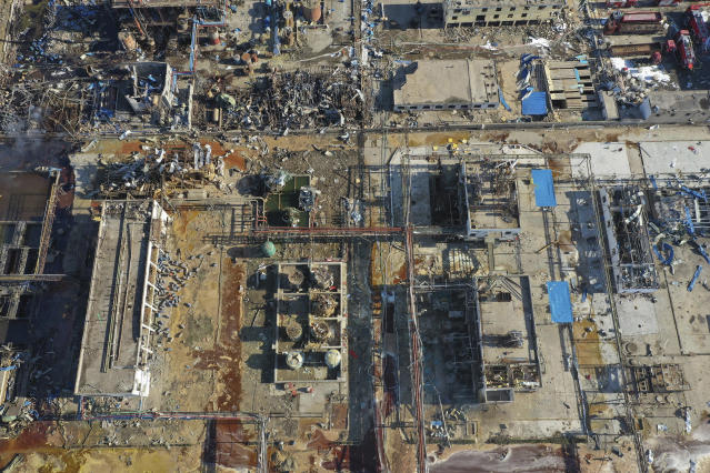 In this aerial photo released by China's Xinhua News Agency, damaged buildings are seen at the site of a factory explosion in a chemical industrial park in Xiangshui County of Yancheng in eastern China's Jiangsu province, Friday, March 22, 2019. The local government reports the death toll in an explosion at a chemical plant in eastern China has risen with dozens killed and more seriously injured. (Ji Chunpeng/Xinhua via AP)
