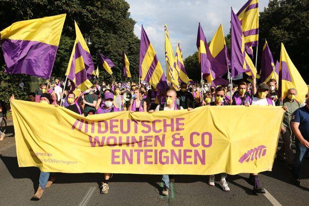 BERLIN, GERMANY - SEPTEMBER 11: Protesters from the Deutsche Wohnen & Co expropriated initiative march along 17 June street in protest against rising residential rental prices on September 11, 2021 in Berlin, Germany. Thousands of people joined the march to protest against rental prices that have been surging in Berlin in recent years. Protesters claim prices are pushing many people out of their neighbourhoods and altering the character of the city. (Photo by Omer Messinger/Getty Images) (Photo: Omer Messinger via Getty Images)