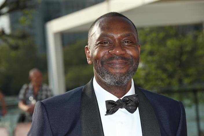 Lenny Henry poses for photographers upon arrival at the British Academy Television Awards' in London, Sunday, May 8, 2016. (Joel Ryan/Invision/AP)