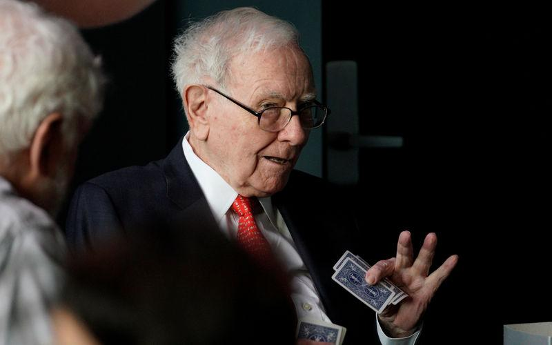 FILE PHOTO - Warren Buffett, CEO of Berkshire Hathaway Inc, gestures while playing bridge as part of the company annual meeting weekend in Omaha