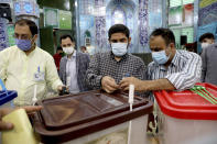 Iranian election officials prepare ballot boxes at a polling station in Tehran, Iran, Friday, June 18, 2021. Iran began voting Friday in a presidential election tipped in the favor of a hard-line protege of Supreme Leader Ayatollah Ali Khamenei. (AP Photo/Ebrahim Noroozi)