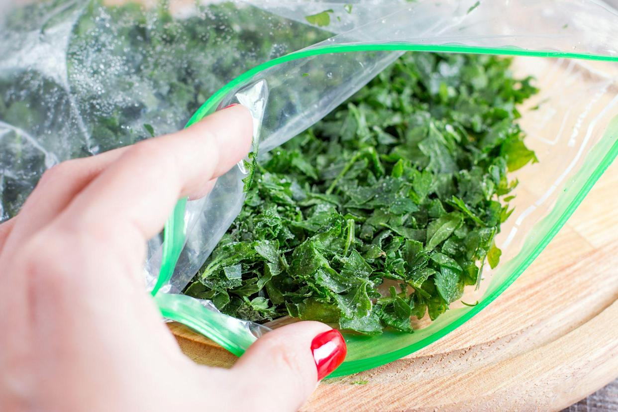 Frozen greens in a bag on a cutting board