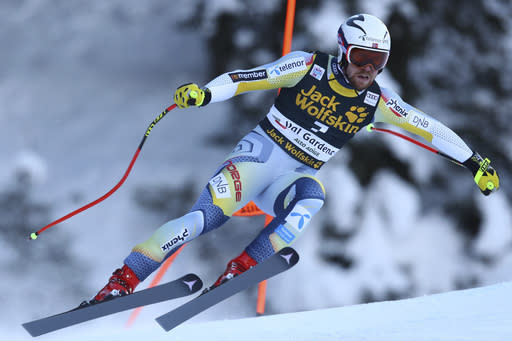 Norway's Aleksander Aamodt Kilde speeds down the course of an alpine ski men's World Cup downhill in Val Gardena, Italy, Saturday, Dec. 19, 2020. (AP Photo/Marco Trovati)